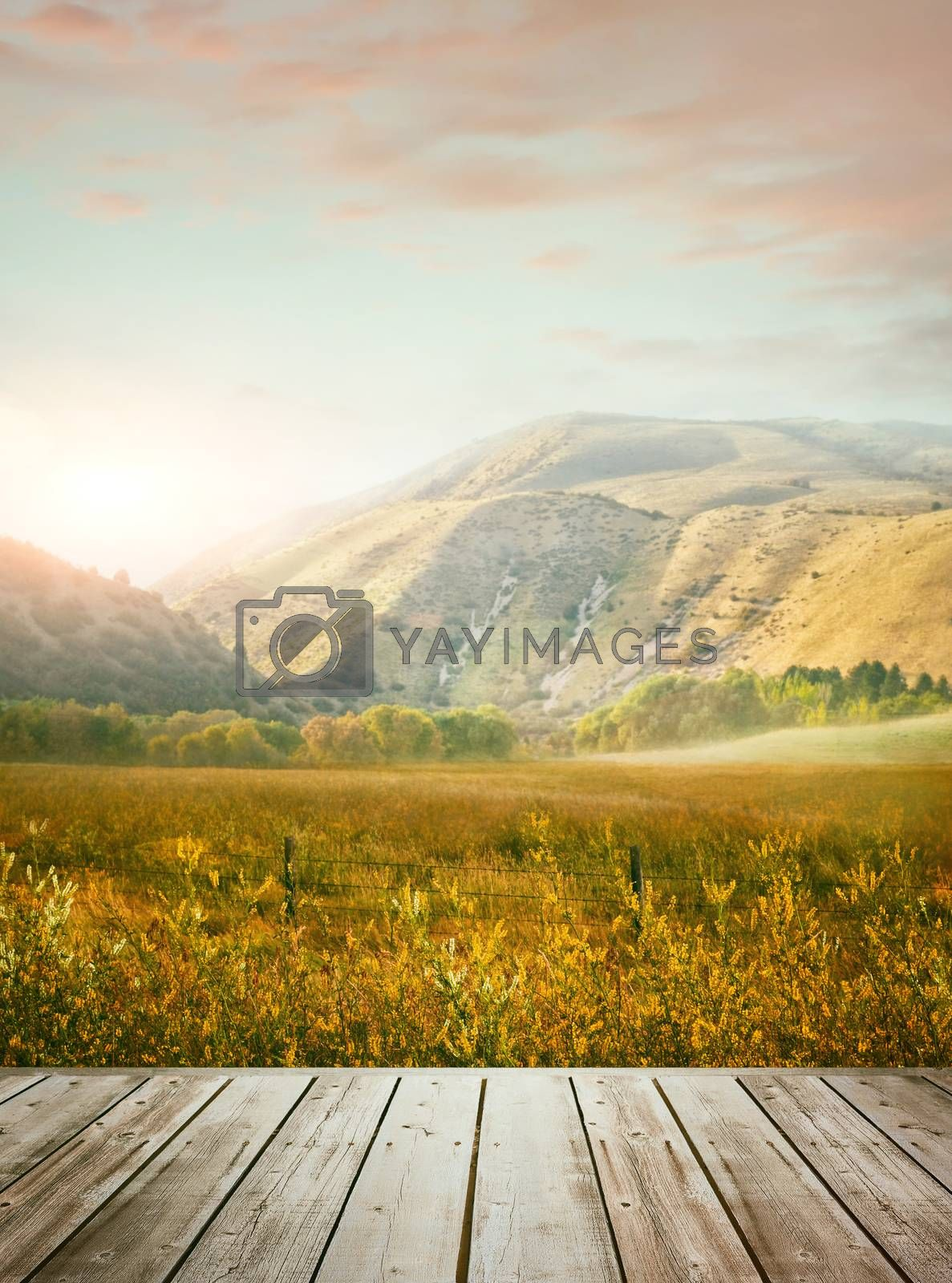 Wooden table with mountains in background