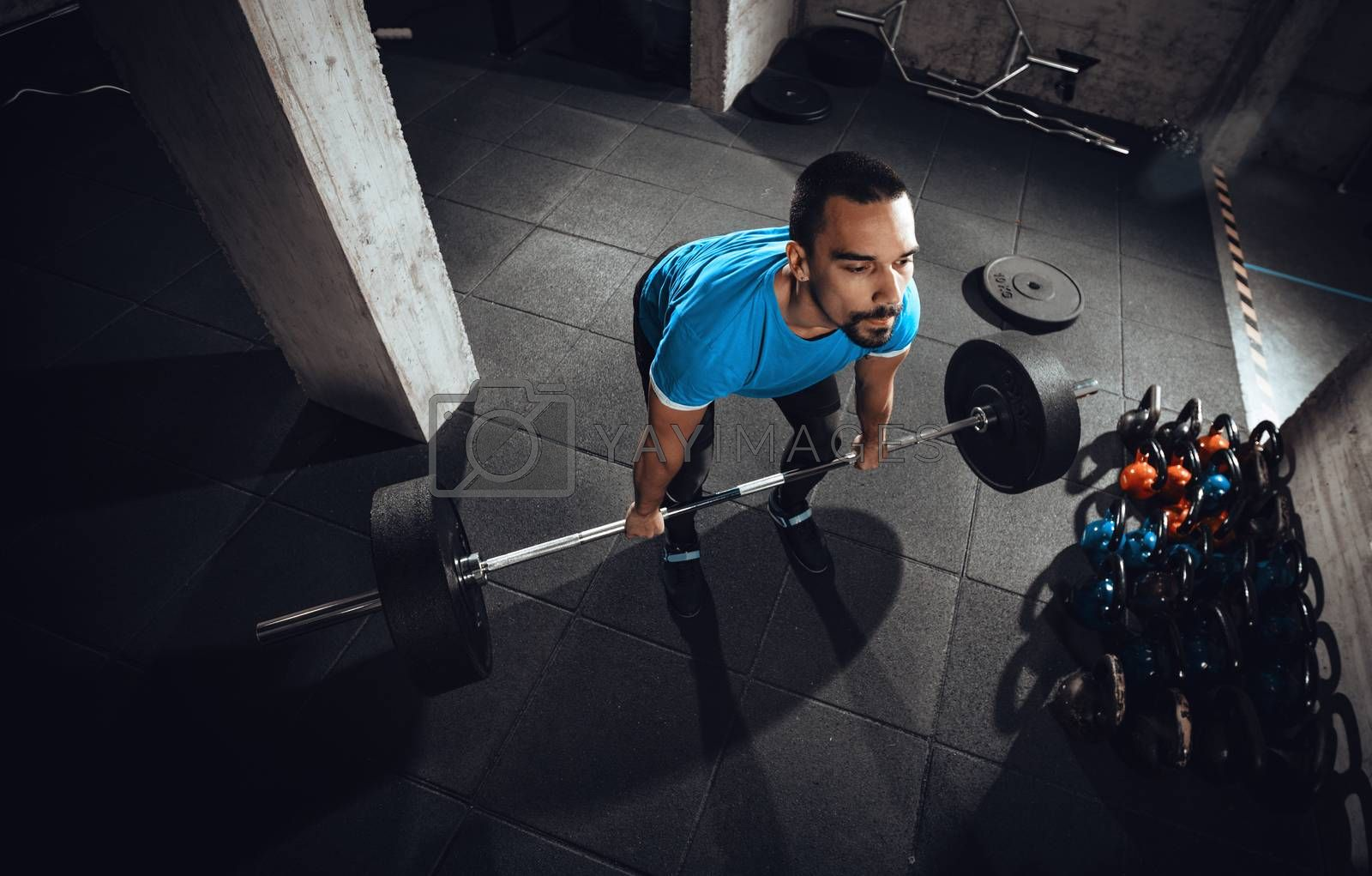 Young muscular man ready to deadlift exercise at the gym.