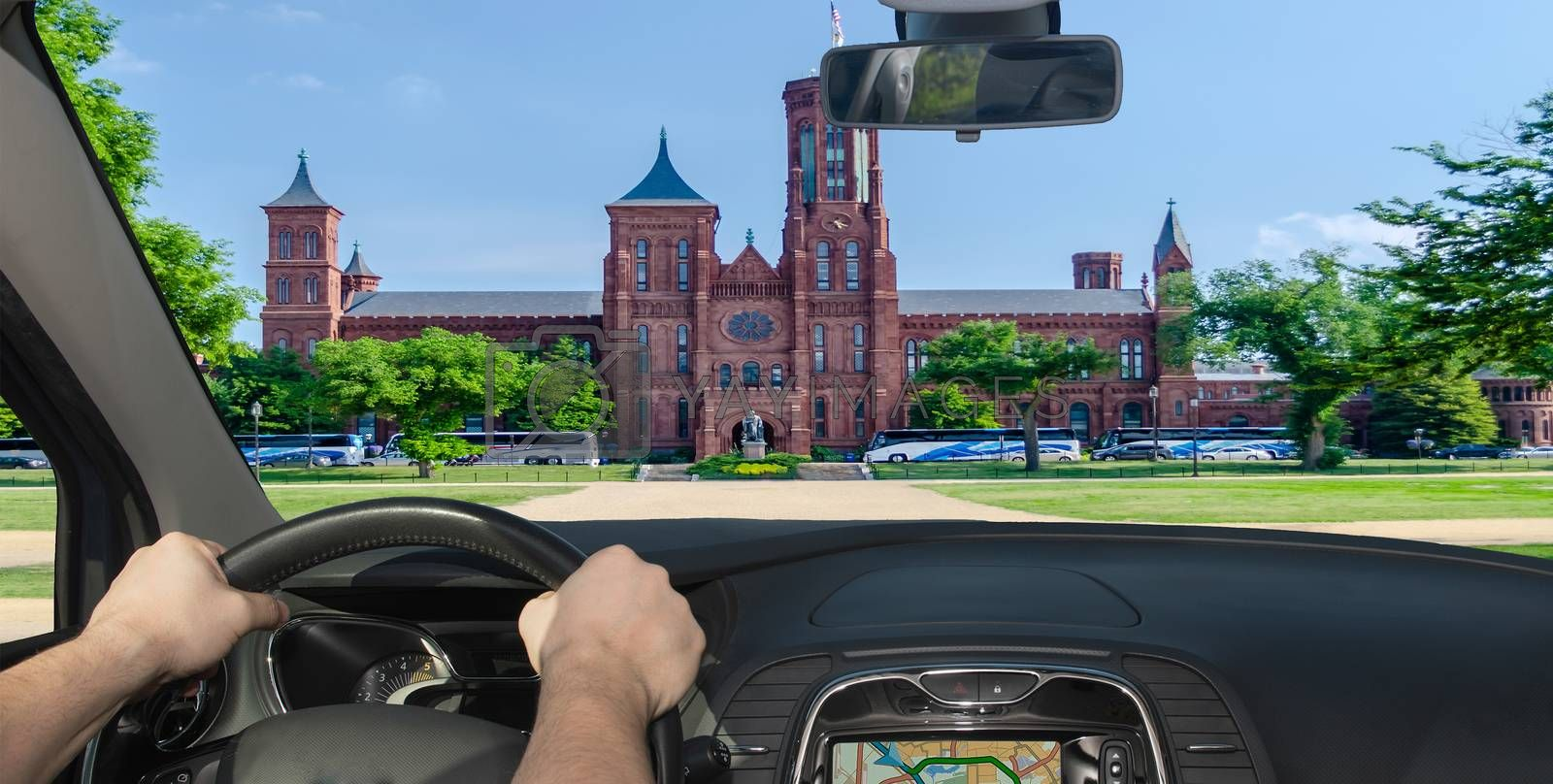 Driving a car towards the iconic Smithsonian Castle along the National Mall in Washington DC, USA