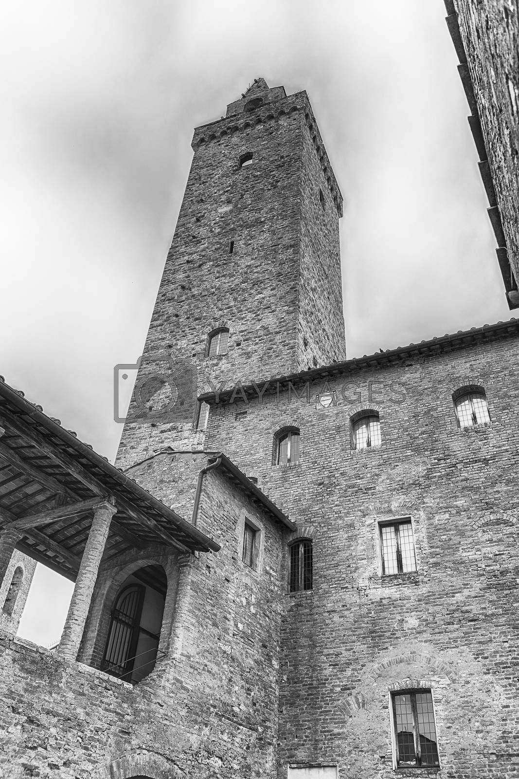 View of Torre Grossa, the tallest medieval tower and one of the main attractions in the central square of San Gimignano, Tuscany, Italy