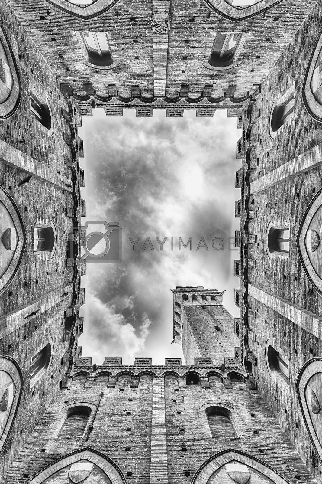 Scenic view from the bottom at the patio of Palazzo Pubblico, major landmark in Siena, Italy