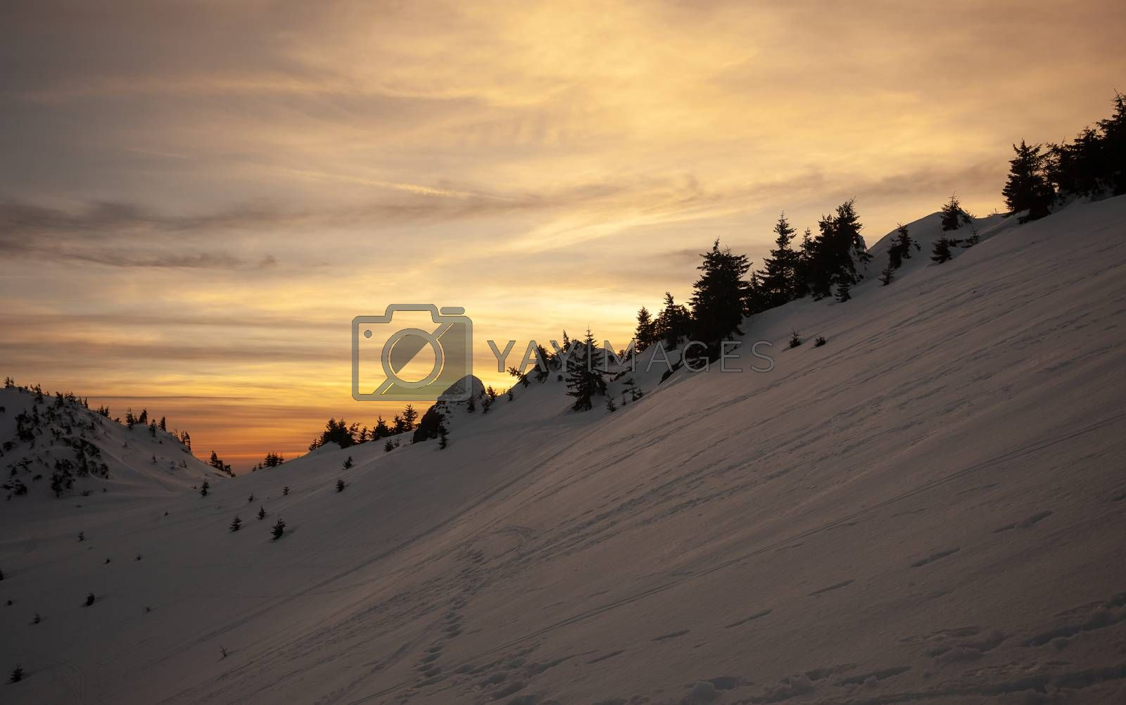 Sunset view from Mount Ciucas on winter, part of Romanian Carpathian Range