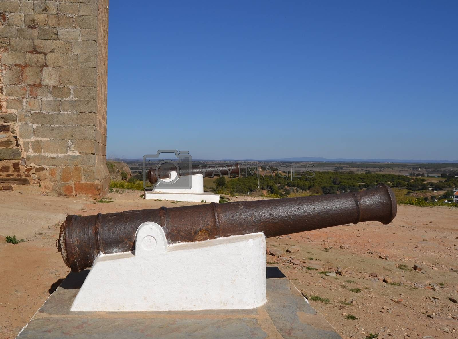 Old cannon near a castle that was used in antiquity for defensive warfare maneuvers