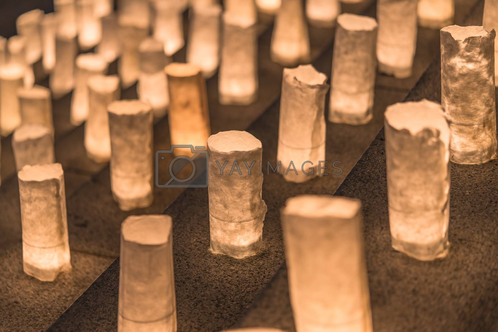 Handmade japanese paper washi lanterns illuminating the stone steps of the Zojoji temple near the Tokyo Tower during Tanabata Day on July 7th.