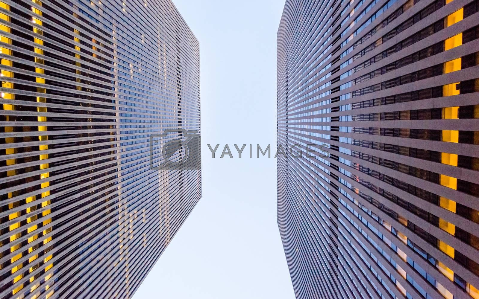 Bottom view of modern skyscrapers in business district of Manhattan, New York, USA. Concept for business, finance, real estate