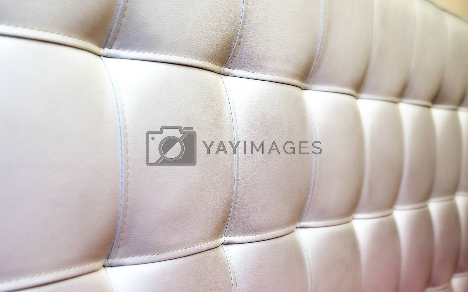 Tufted white leather headboard texture, used for background