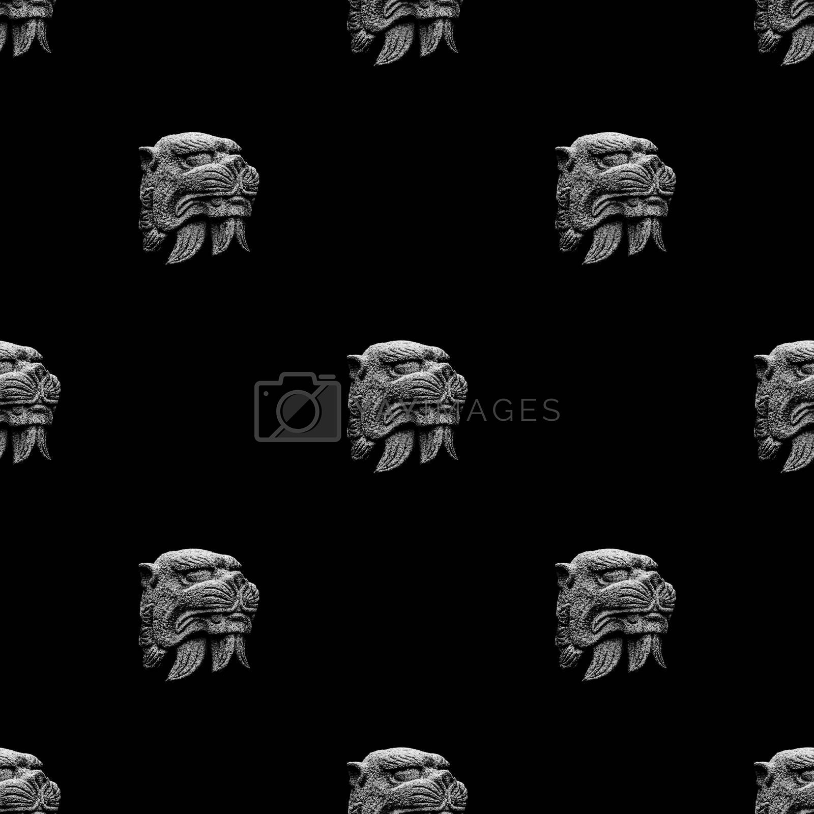 Conversational seamless pattern design mythological feline head stone sculpture motif in black and white colors