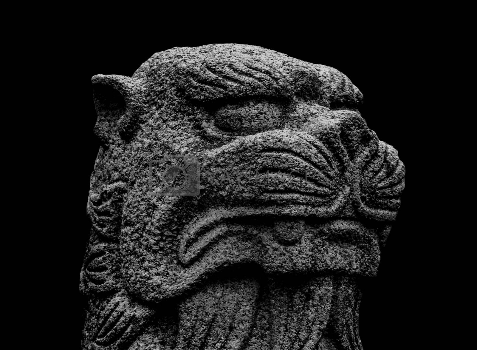 Japanese mythological feline stone sculpture isolated on black background
