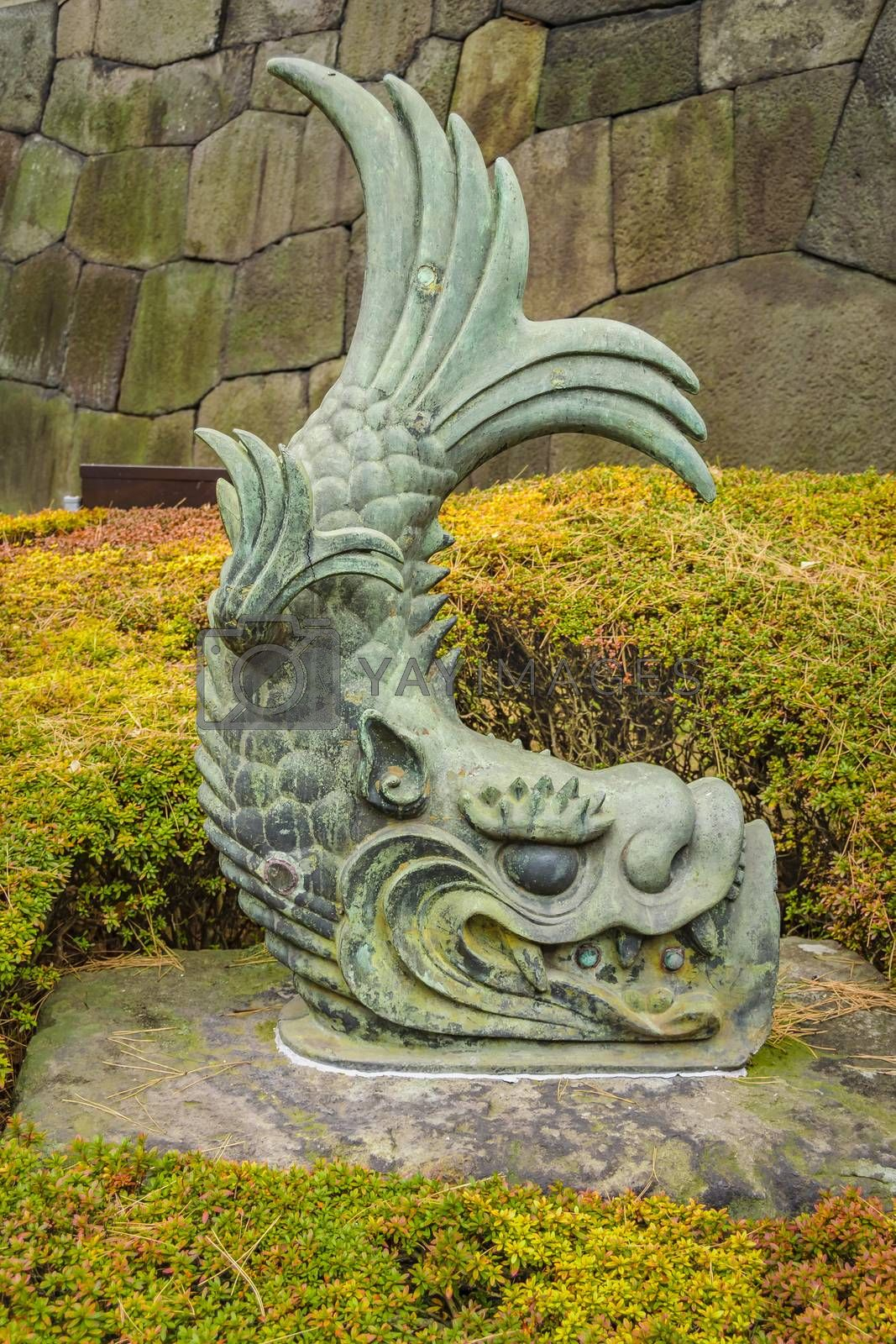 Japanese mythological fish stone sculpture, imperial palace, tokyo, japan