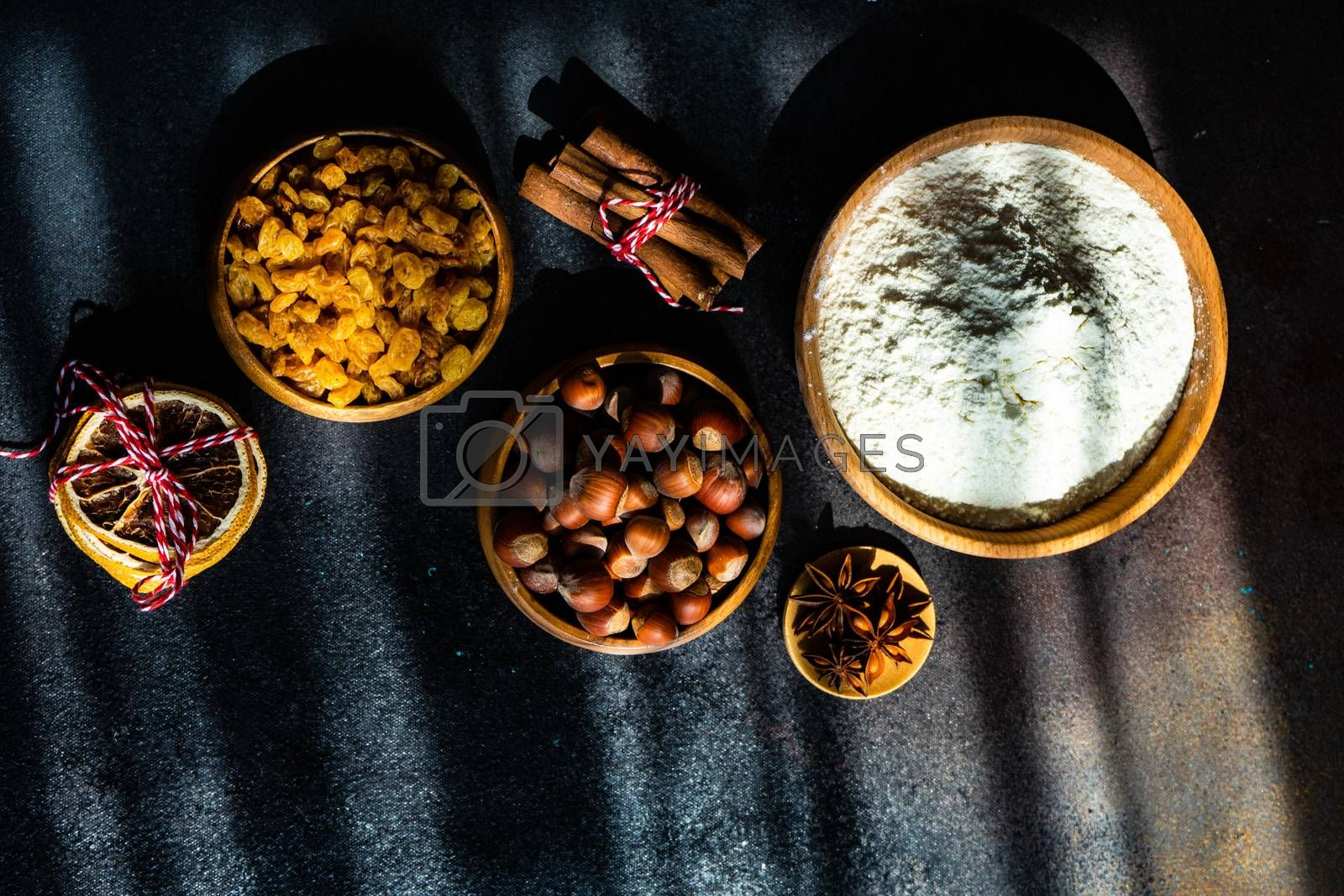 Christmas cooking concept with cookies cutters on stone background with deep shadows and  copy space