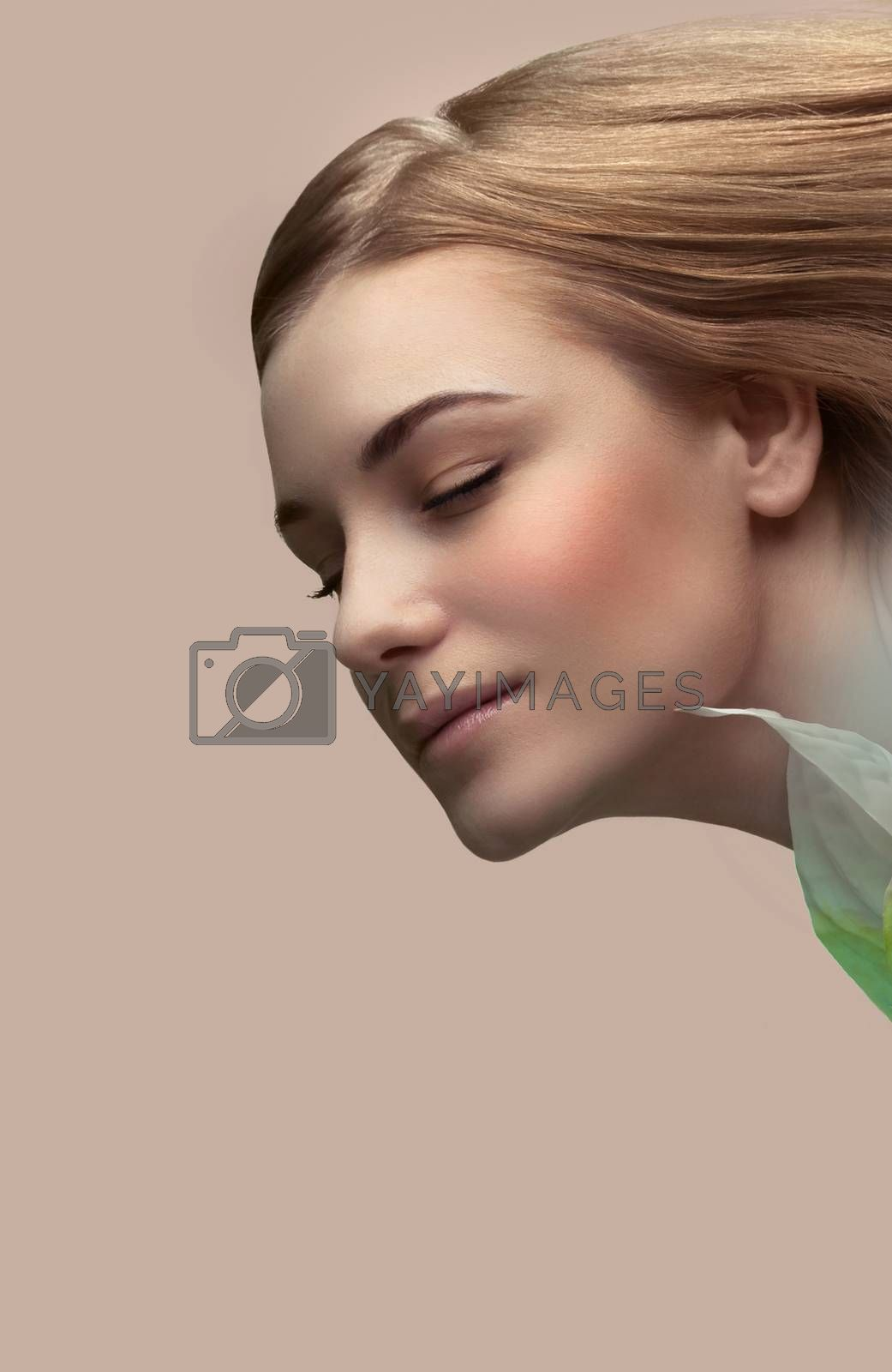 Portrait of a gentle woman with calla flower isolated on beige pink pastel background, genuine beauty, conceptual photo of a spa therapy and skin care, blank space for text