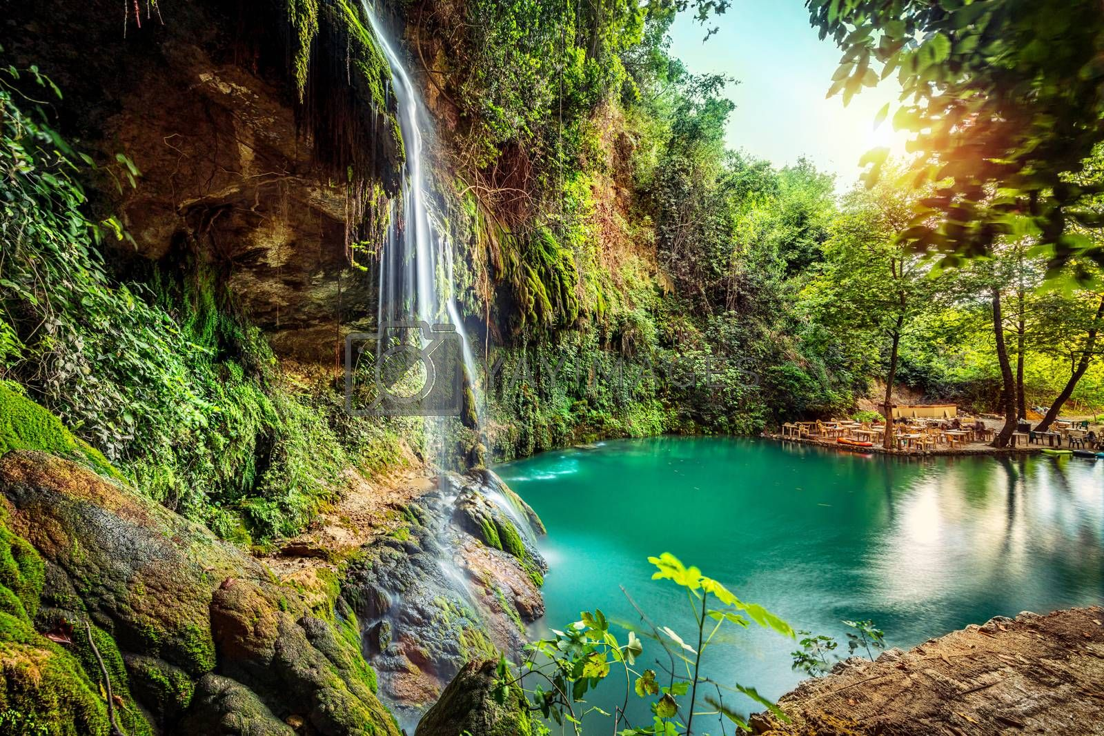 Peaceful view on the waterfall and the fresh greenery around the picturesque lagoon, Baakleen, Lebanon