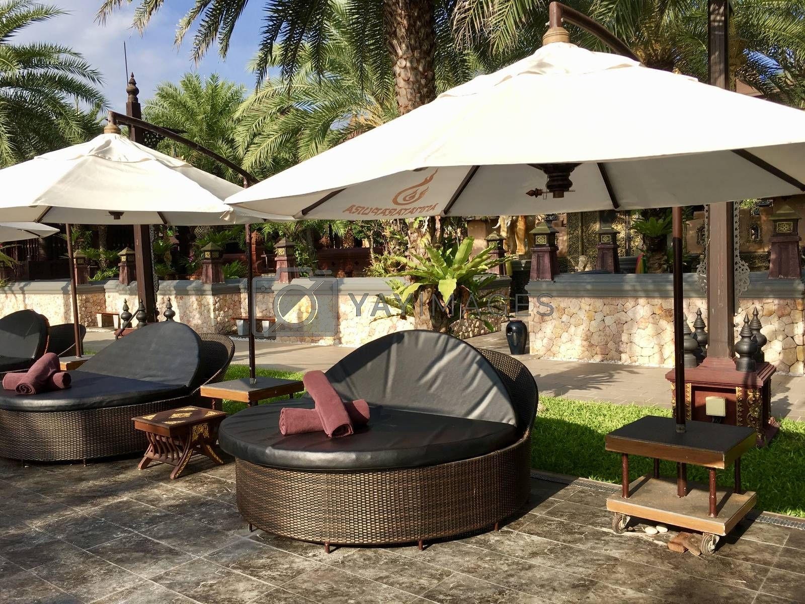 FEBRUARY 27, 2017: Ammatara Pura Pool Villa, Koh Samui, Thailand. Beautiful resort pool Swimming pool of luxury resort and spa near the sea. Beach chairs near swimming pool in tropical resort
