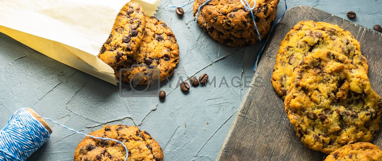 Homemade cookies with chocolate and coffee on rustic background with copy space