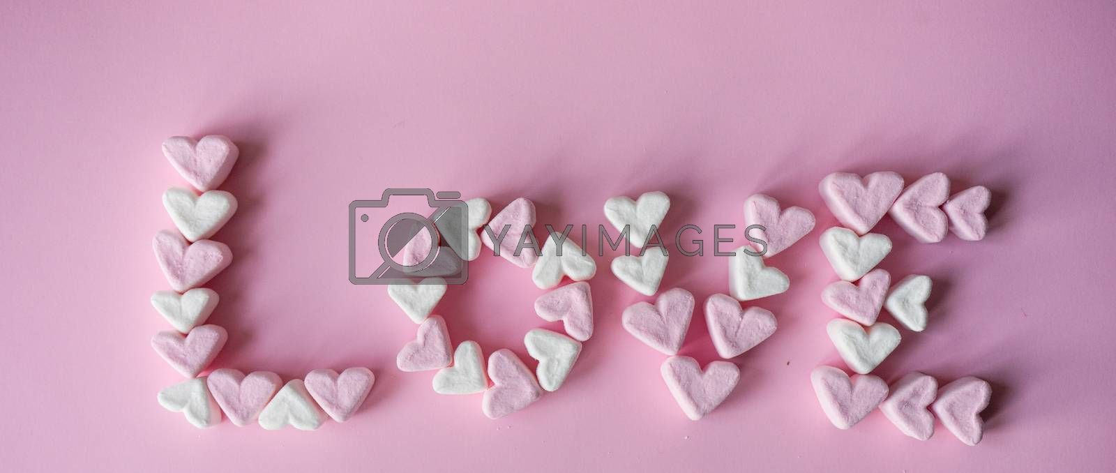 St, Valentines concept with word LOVE made with  heart shaped marshmallow on pink background