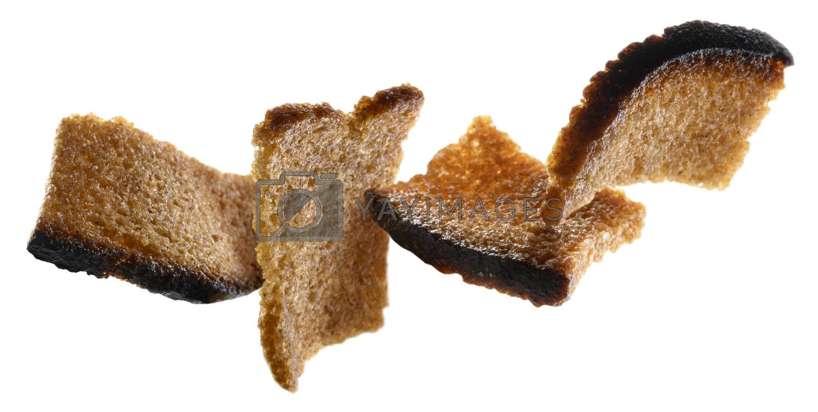 Rye croutons levitate on a white background.