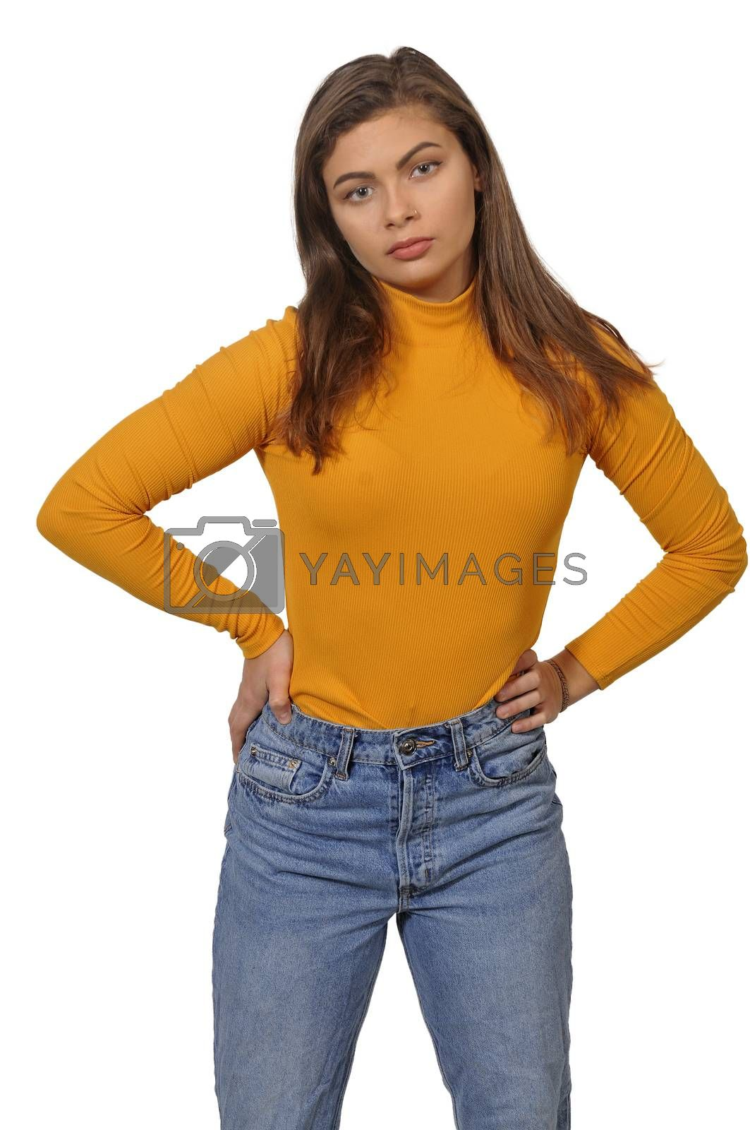 Beautiful young attractive woman in jeans modeling a pose