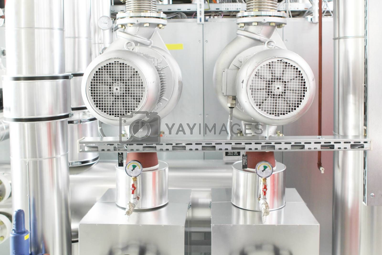 chrome pipes in heating and AC rooms in buildings of factories and hospital. With silver color