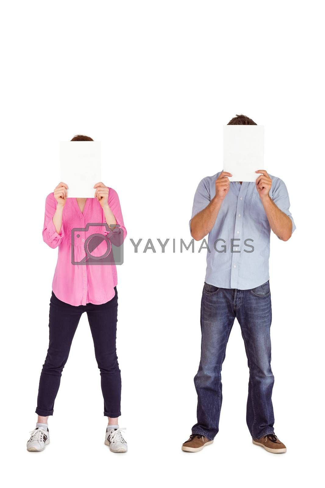 People holding sheets over faces on white background