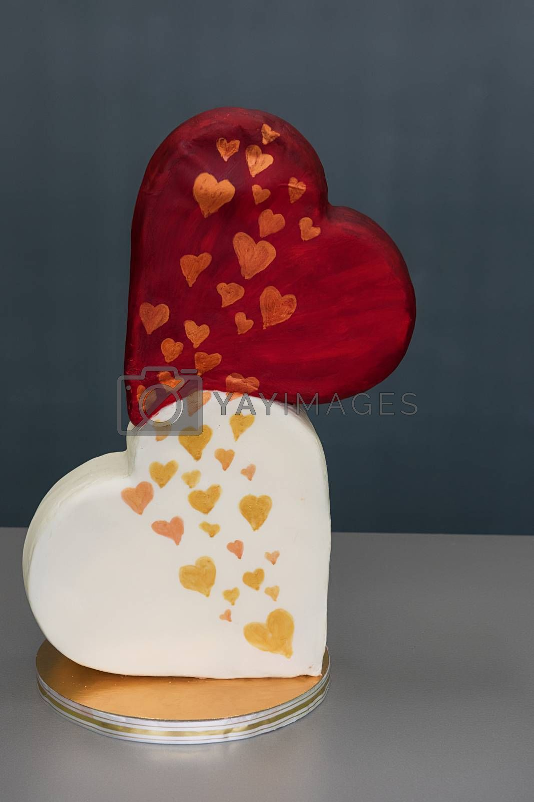 Wedding cake as two hearts on grey background