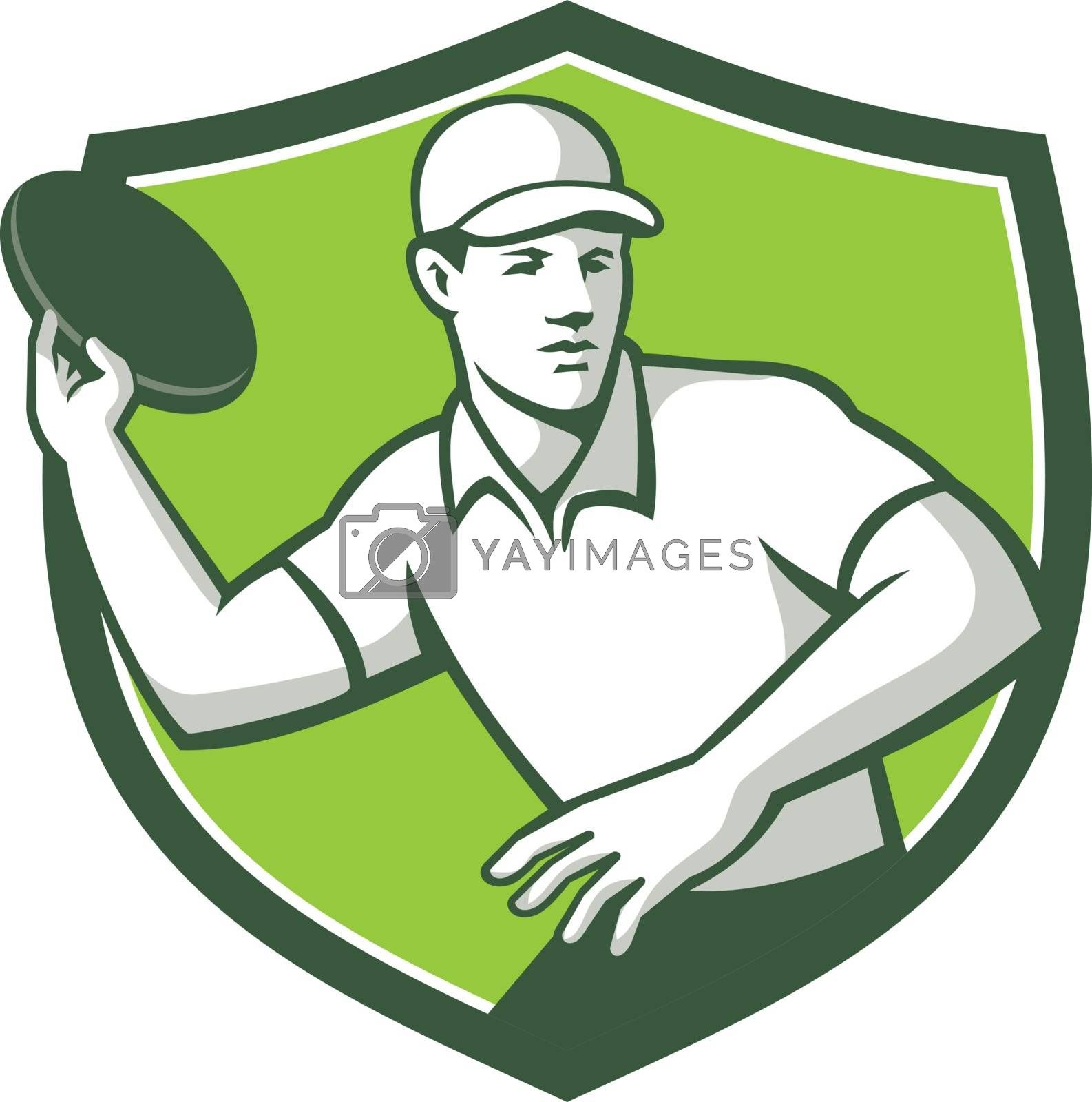 Mascot icon illustration  of an disc golf player throwing a flatball or frisbee set inside crest or shield shape viewed from front on isolated background in retro style.