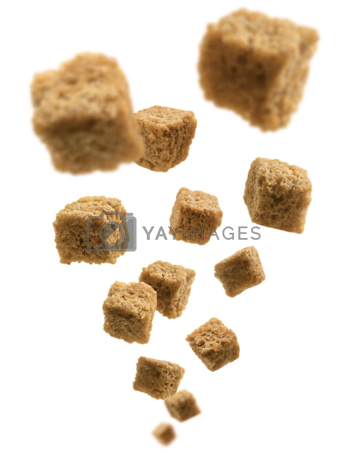 Bread croutons levitate on a white background by butenkow