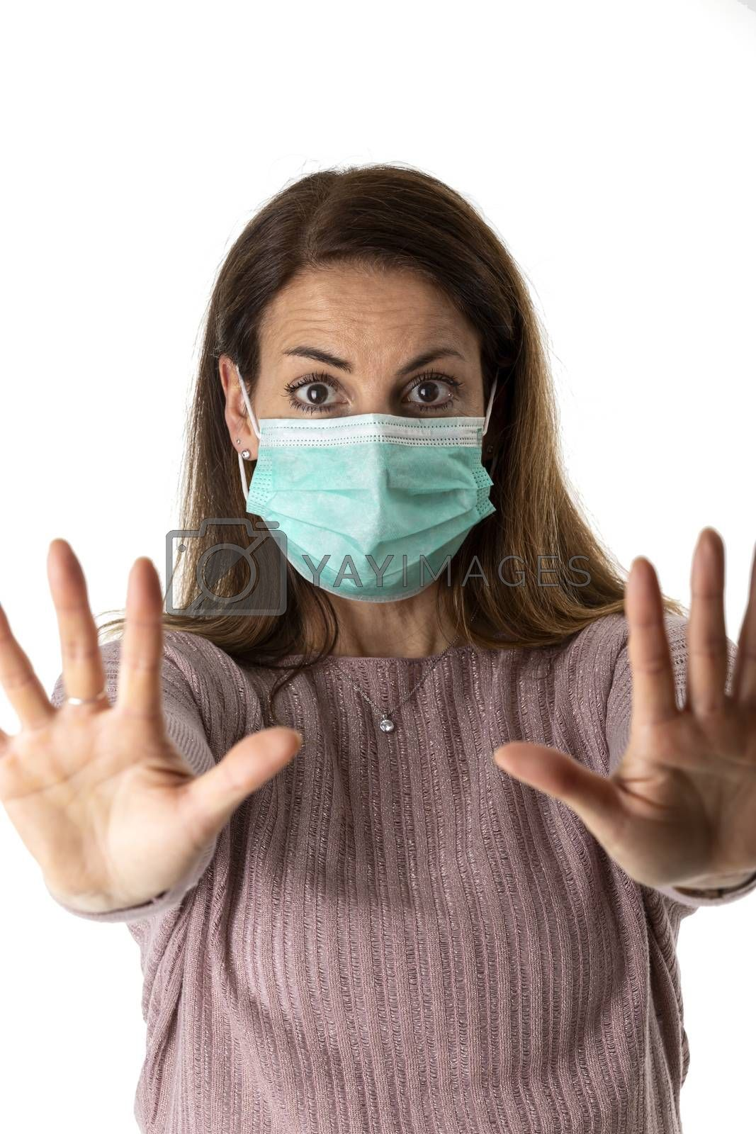 scared woman with a medical mask