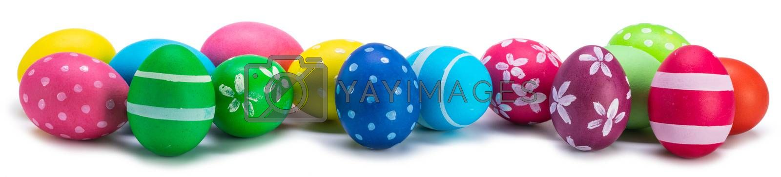 A row of decorated easter eggs isolated on white background