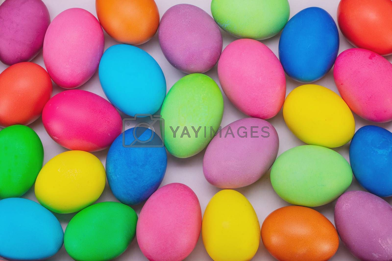 Many colorful easter eggs multicolored close up background top view
