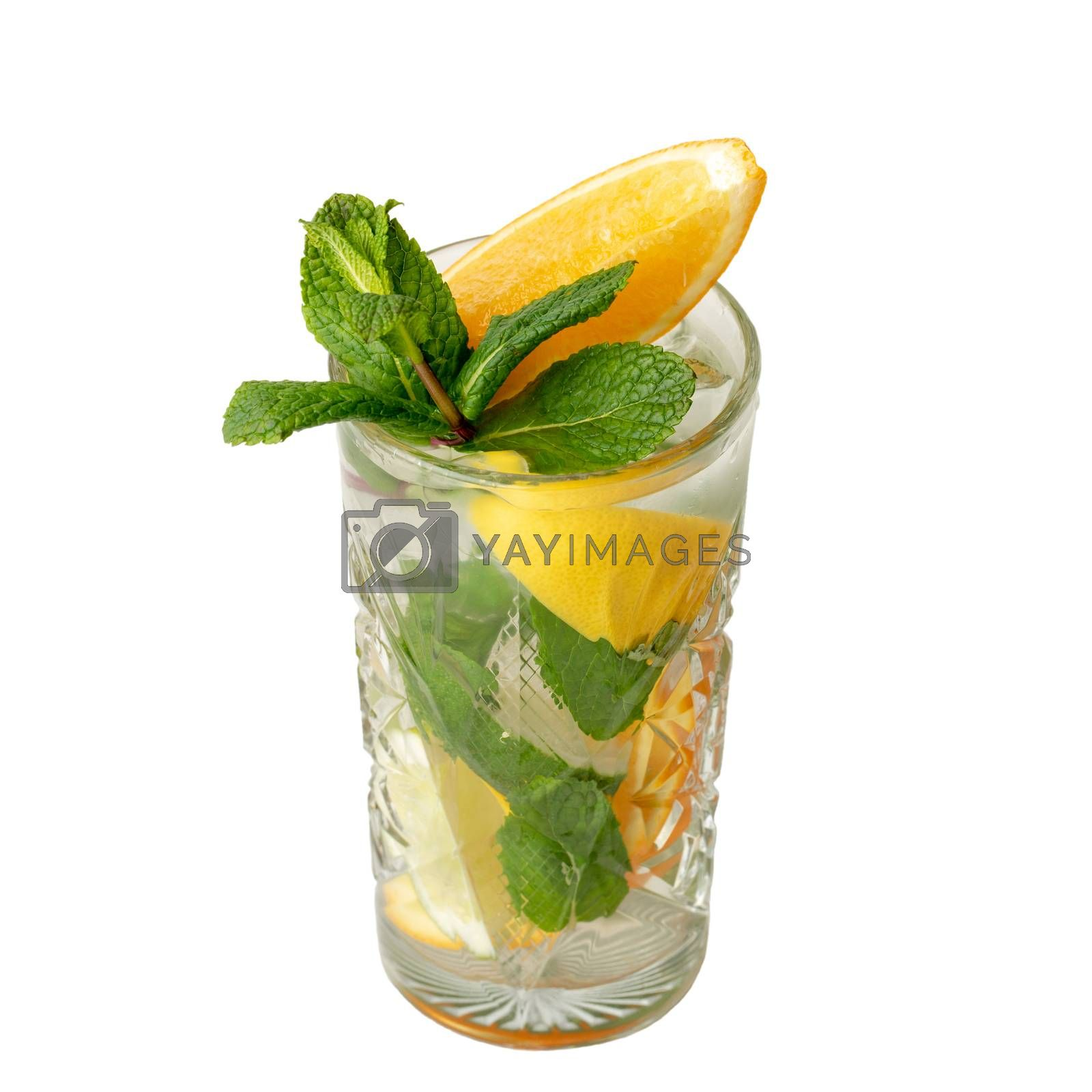 Cold alcohol cocktail drink with slices of lemon and lime, mint leaf isolation on a white