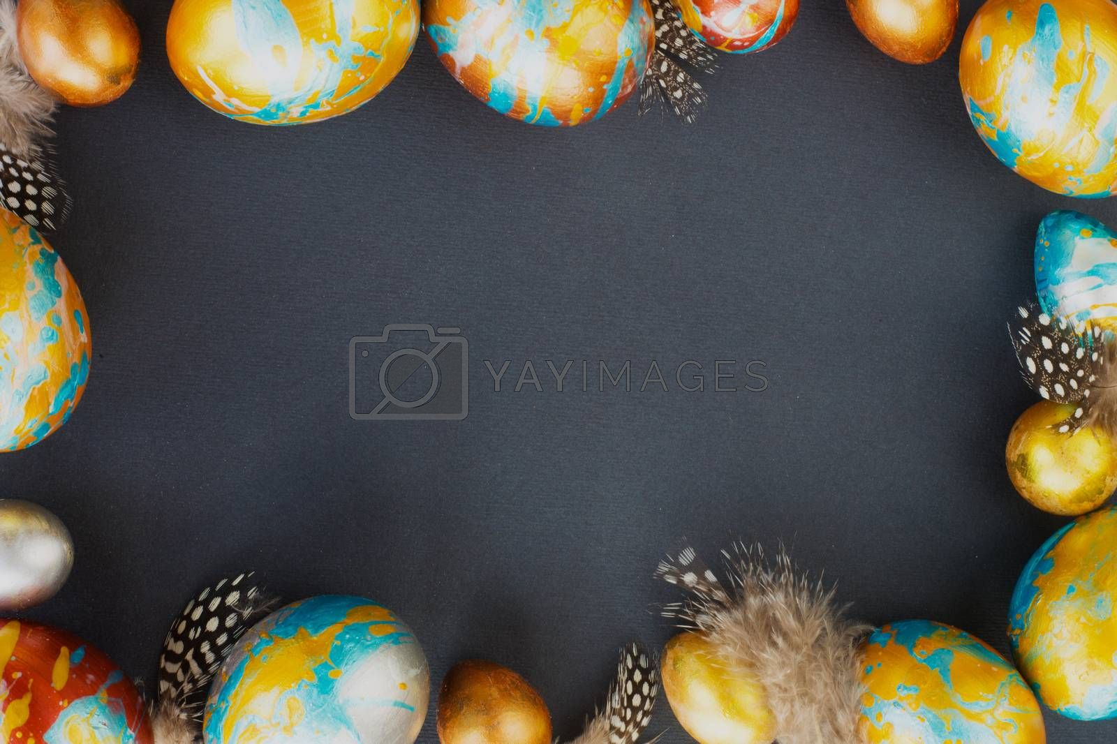 Perfect colorful handmade easter eggs on black paper background , shape of border frame corner with copy space for text content , happy easter card