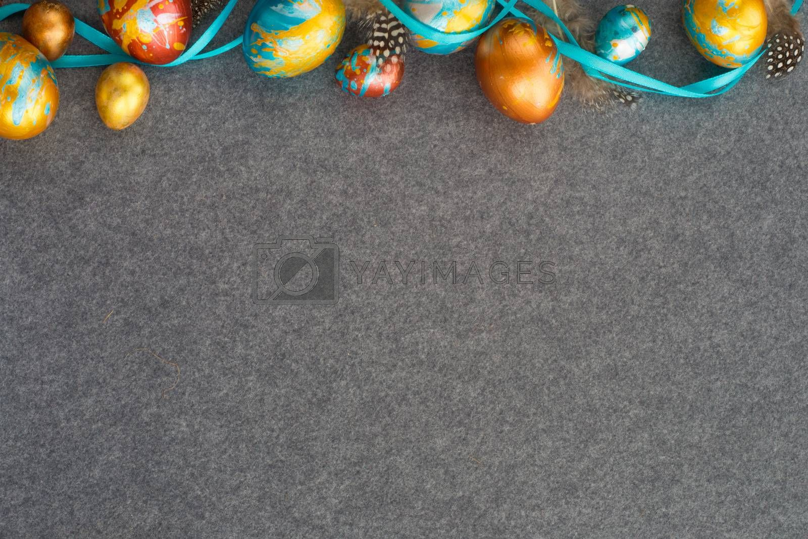 Perfect colorful handmade easter eggs on gray textile background , shape of border frame corner with copy space for text content , happy easter card