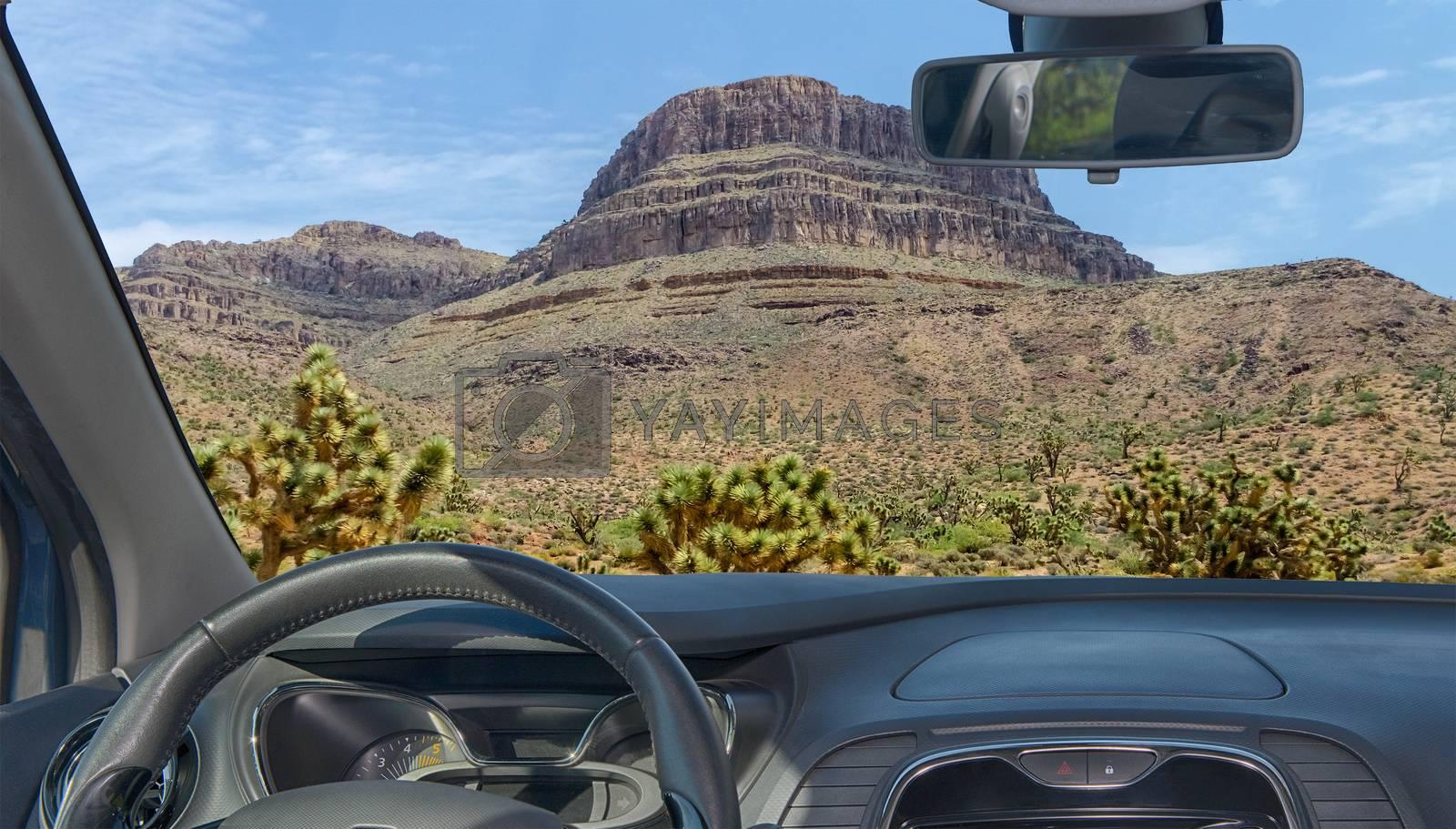 Car windshield view of Spirit Mountain, Grand Canyon, Arizona, U by Marco Rubino