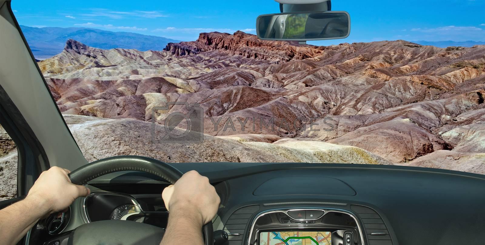 Driving a car towards Zabriskie Point, Death Valley, California, by Marco Rubino