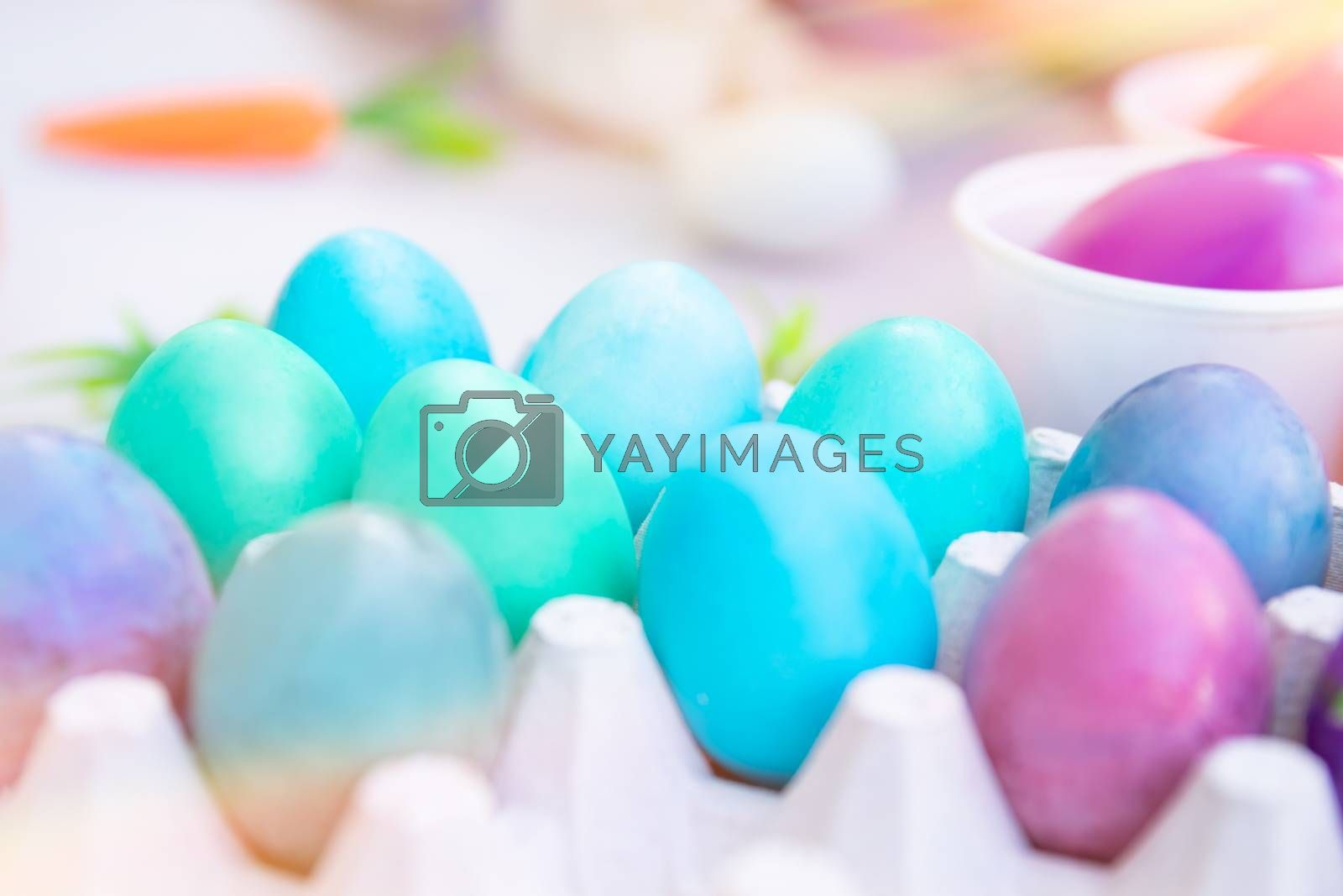 Closeup photo of a many different colorful Easter eggs, traditional painted Easter food, child's handmade art, happy religious holiday