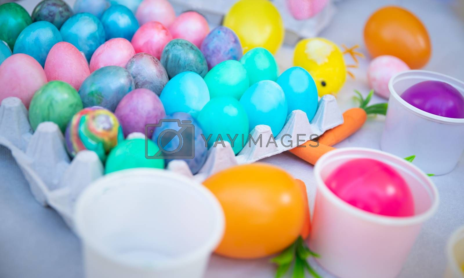 Closeup photo of a many different colorful Easter eggs, festive decoration, traditional painted Easter food, child's art, happy religious holiday