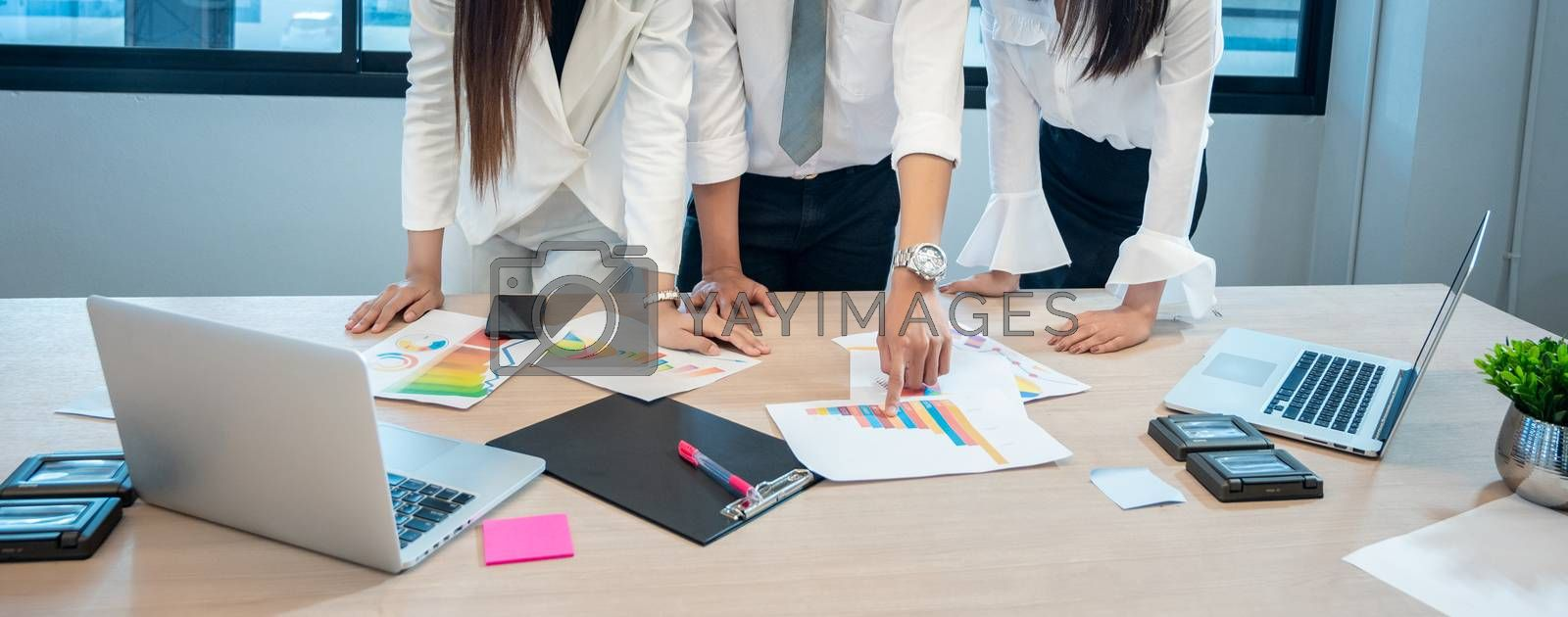 Business people are meeting and graphing business growth on a desk