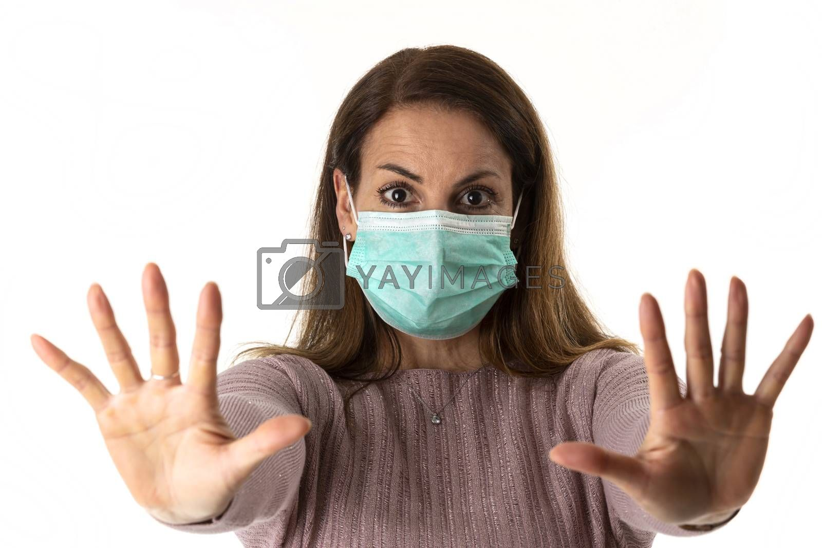scared woman with a mask on white