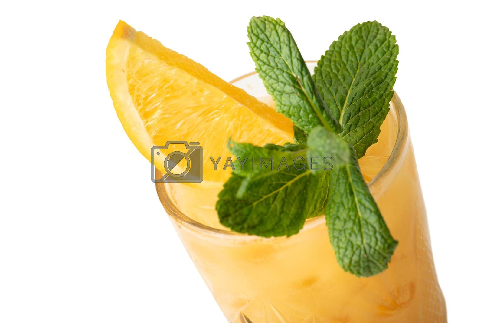Cold multi fruit cocktail drink with slices of orange, mint leaf isolation on a white
