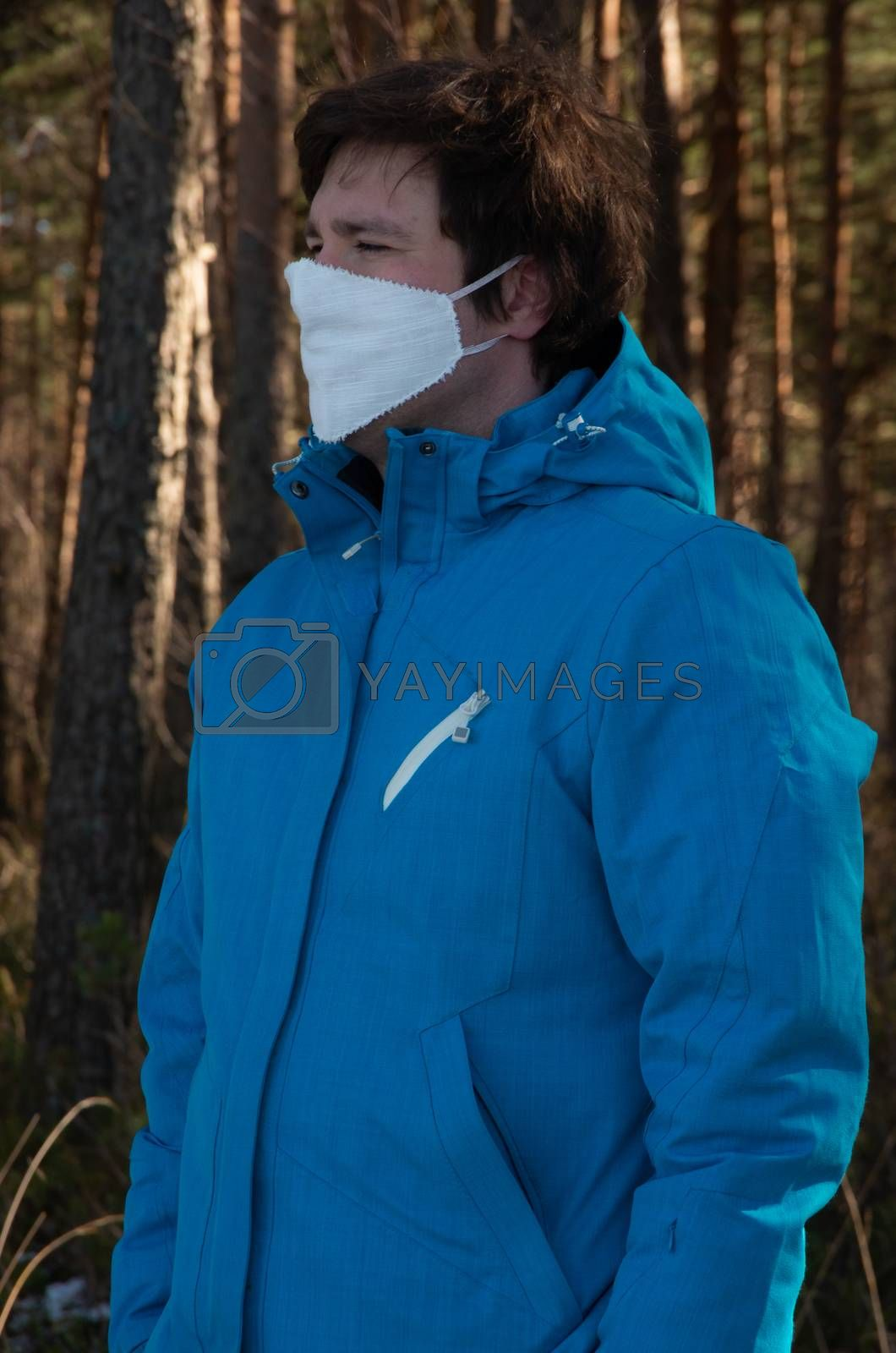 Virus, man with white face mask in a blue jacket, coronavirus, COVID-19