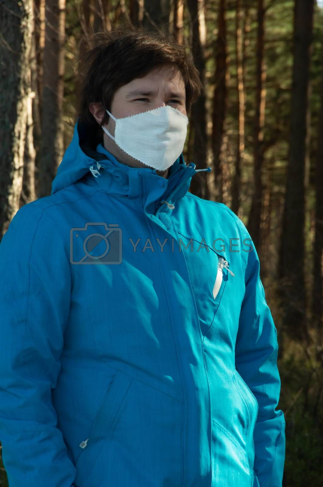 Virus, a man with white face mask in a blue jacket, coronavirus, COVID-19
