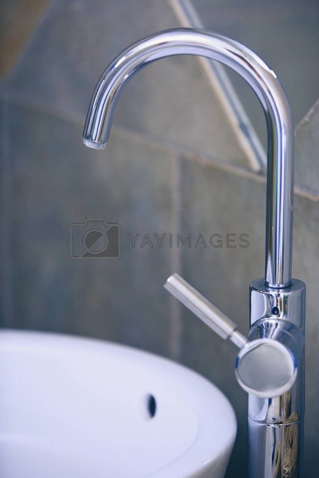 Water tap and sink in domestic bathroom by Novic