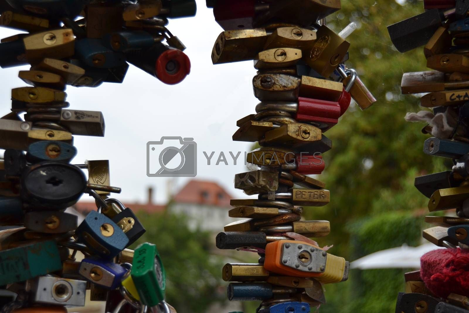 Many padlocks on the railing of a bridge that represent the eternal love between lovers