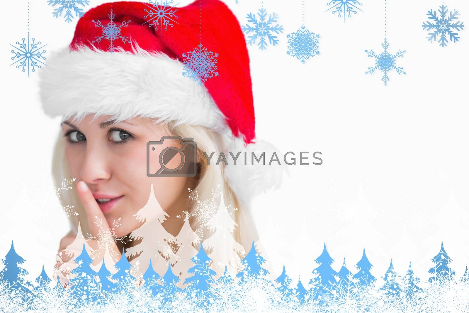 Woman in santa hat making silence gesture against snowflakes and fir trees