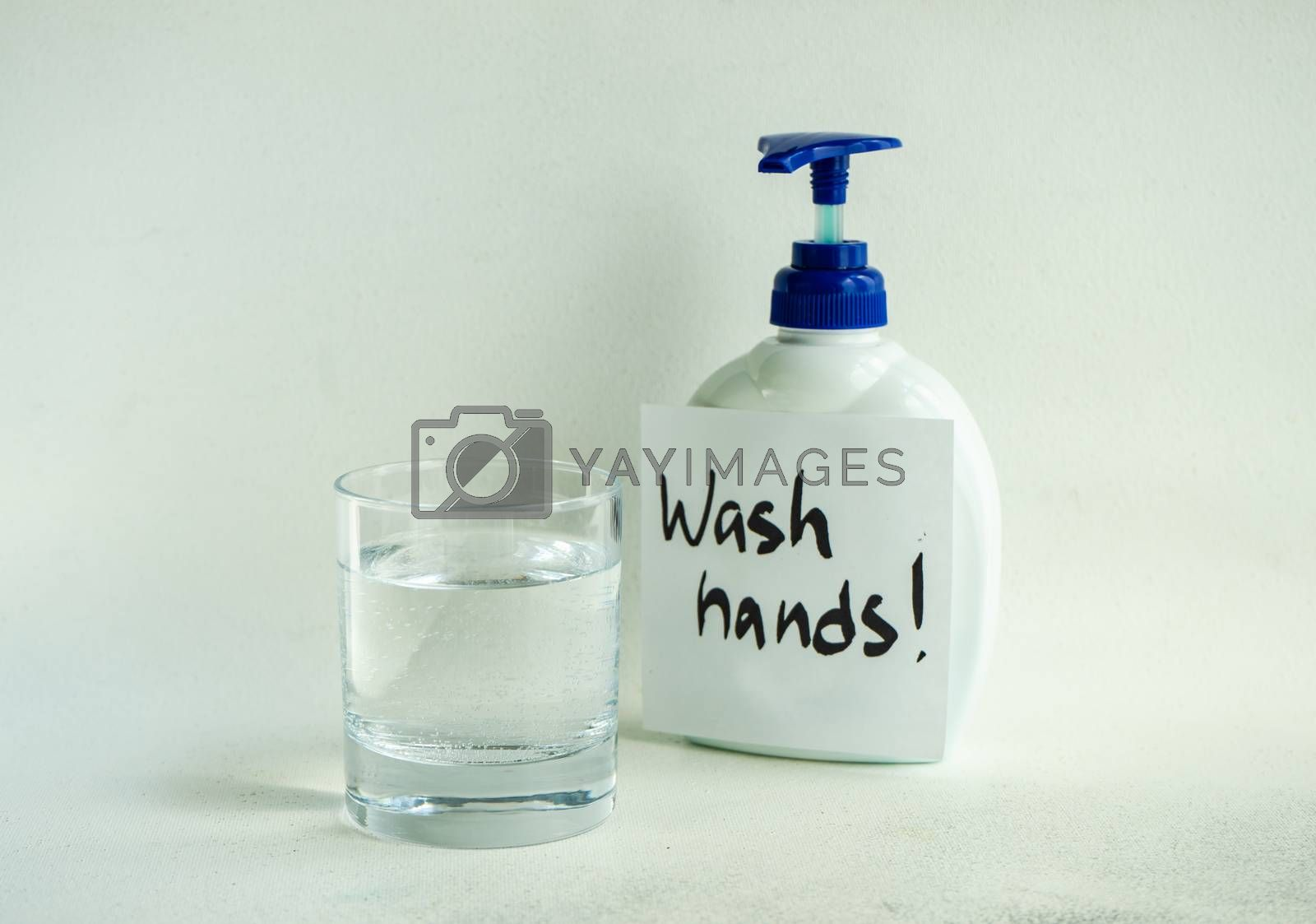 COVID-19 virus concept with antibacterial soap on concrete background with copy space
