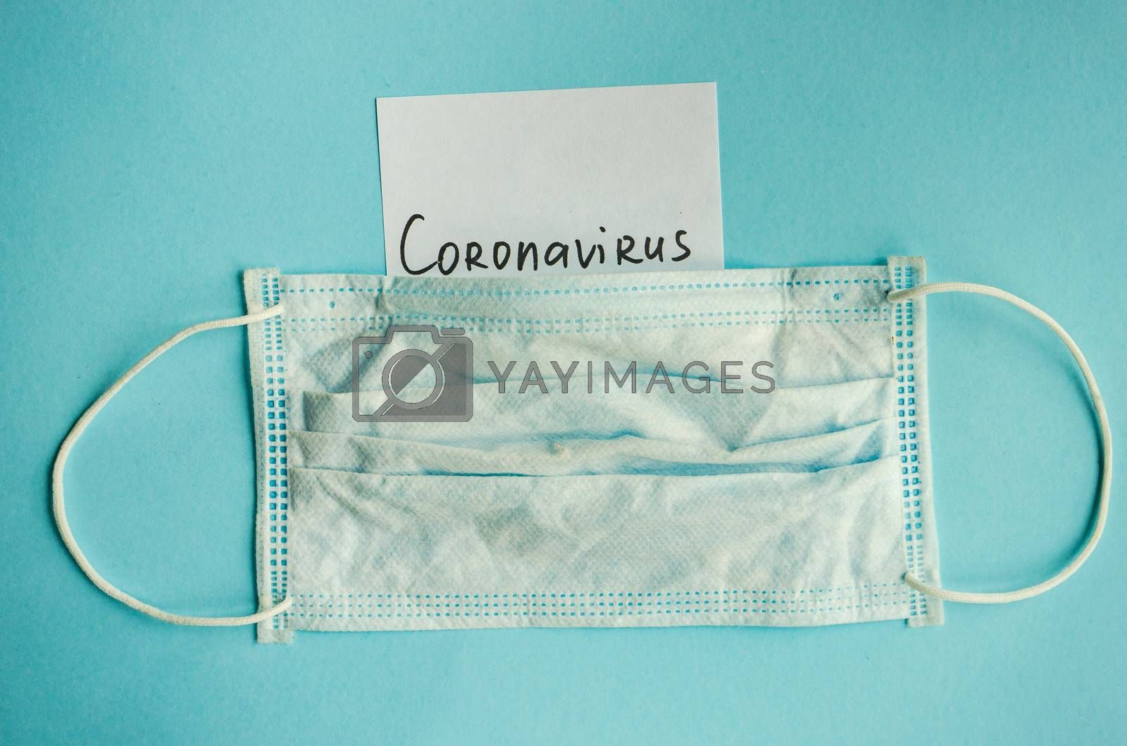 COVID-19 virus concept with face mask on pastel background with copy space
