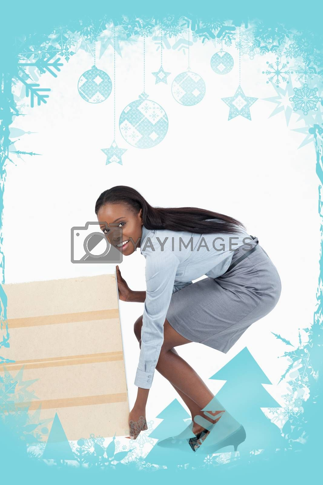 Portrait of a businesswoman dragging a panel against christmas frame