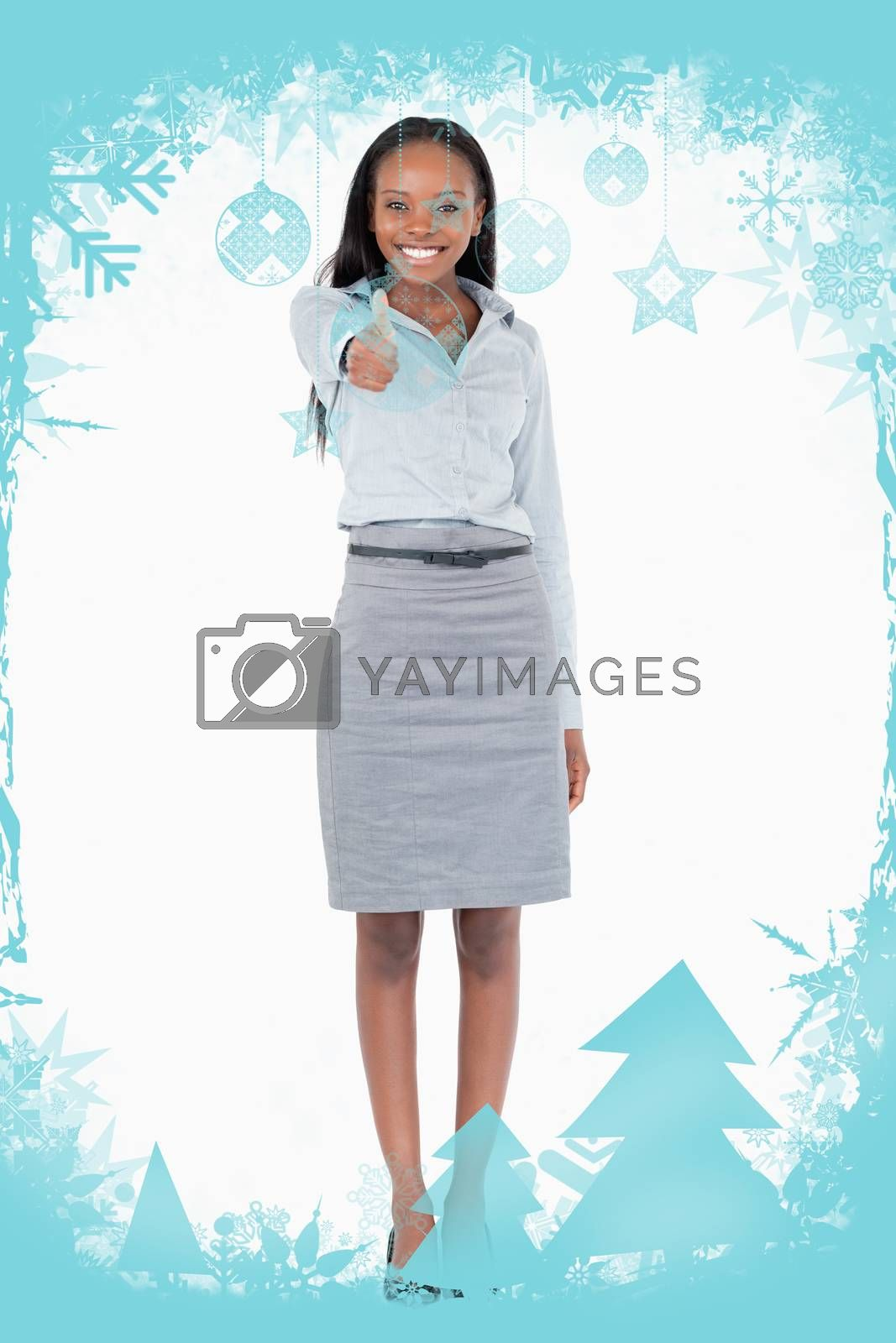 Portrait of a businesswoman with her thumb up against christmas frame