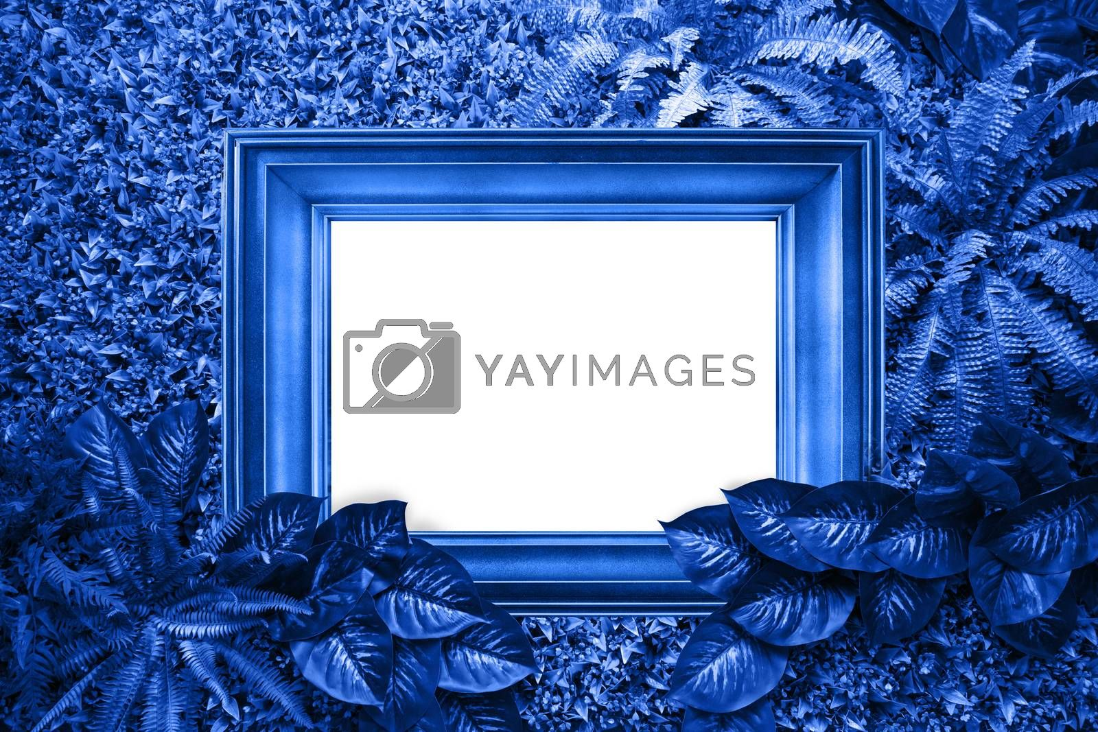 Classic blue color background from leaves and white blank for your design or text. Color of the 2020