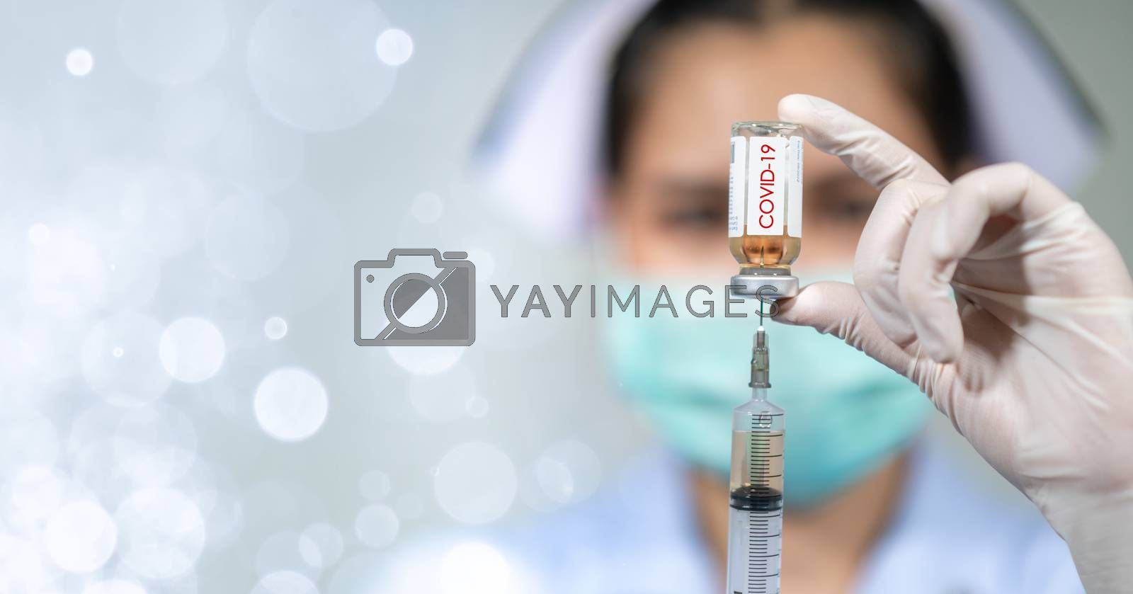 The doctor put on a mask and was injecting with coronavirus covid-19.